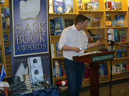 Jim Daschuk reading from his book at an SBA event in March.